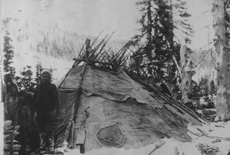 A small Innu shaputuan in northern Labrador. One can just make out a toboggan leaning up against the backside of the dwelling (photo courtesy Them Days, photographer unknown)
