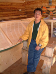 Alistair Pone, one of Pien Penashue's apprentices, stands proudly beside the prototype of his first canoe completed in the fall 2005. With the support of the Sheshatshiu Innu First Nation, Alistair hopes to make canoes commercially (photo Alexander Andrew, 2005).
